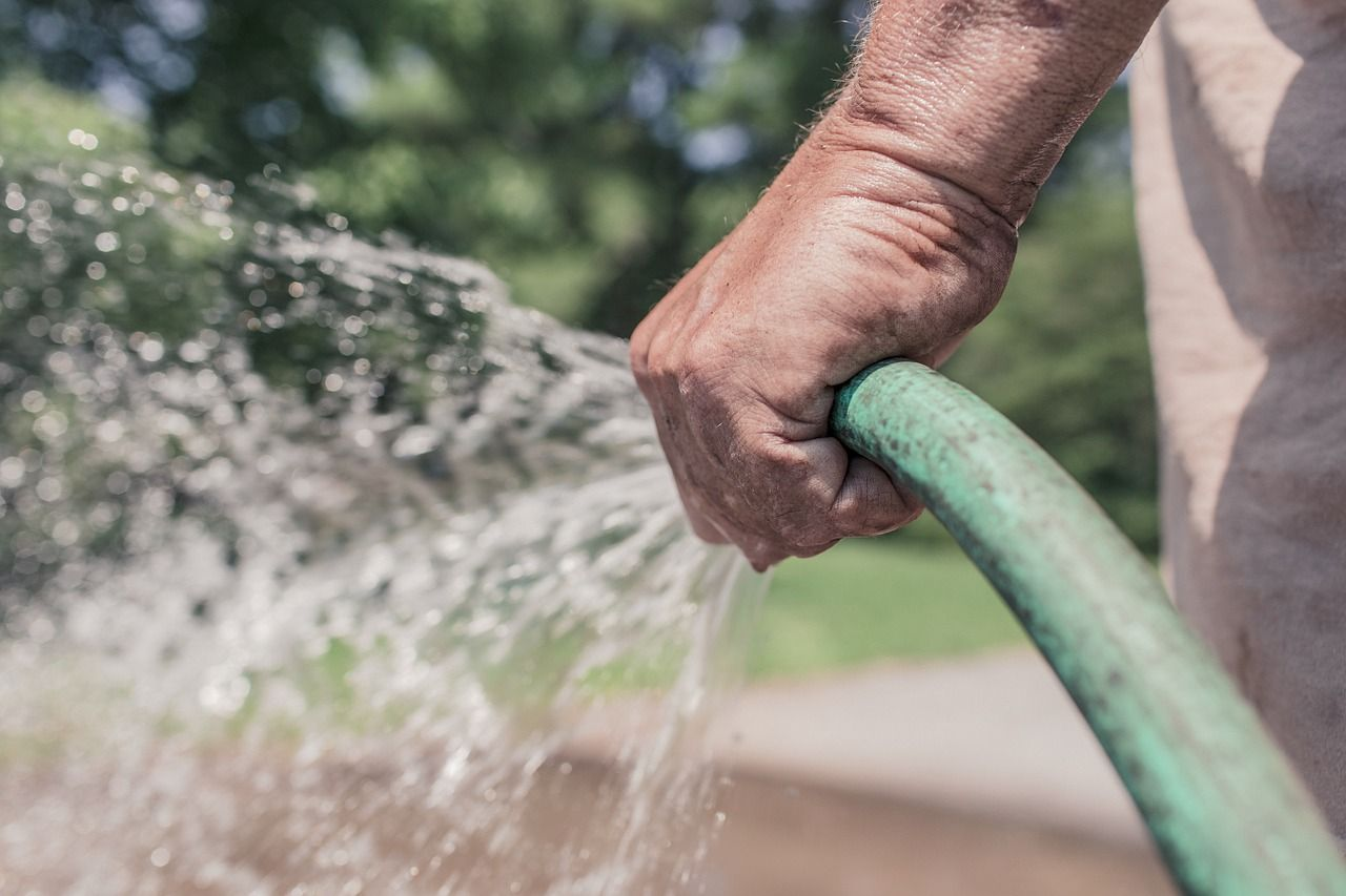 best way to water lawn without a sprinkler system